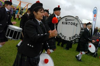 Grampian Fayre was held on Saturady at the B.A.Store at Lyne of Skene, Aberdeenshire. The cast of Emmerdale attended and arrived by helicopters courtesy of Bristows. Kintore Pipe Band warm up before escorting the cast of Emmerdale to the VIP tent. Photograph by Tim Allen. 12/6/2010