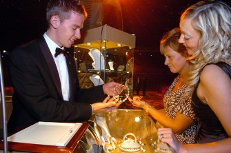 The Oil Barons' Ball held at AECC (Aberdeen Exhibition and Exhibition Centre) Jane Doubenmier (centre) and Sarah Youngson (Grant Prideco table) admire jewellery from Angus Carry. Picture by COLIN RENNIE Saturday, August 18, 2007 .