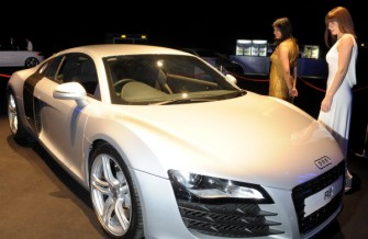 ENERGY BALL 2008 - (from left) Debjani Raffan and Louisa Manson looking at an Audi R8 at the Energy Ball 2008, AECC. Picture by KEVIN EMSLIE .