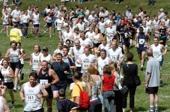 FUN IN FOCUS - Emmerdale Extravaganza at Inchmarlo Golf Centre, Banchory. Crowds cheer the runners on their way out of the arena in the 10k run. copy: ? Pic: Gordon Lennox 05/06/2004